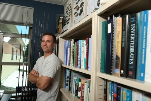David Taylor stands in his office at Roger Williams University (Source: David Silverman for Roger Williams University)