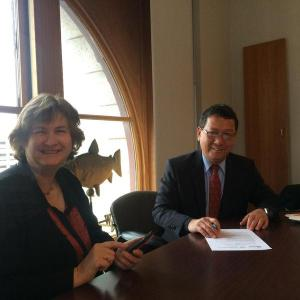 New England Aquarium President and CEO Nigella Hillgarth with Undersecretary Asis Perez at the signing of the Memorandum of Understanding