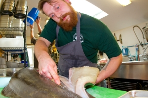 Chef Max Miller of The Landings Restaurant in Rockland, Maine filleting a locally-landed Atlantic halibut.